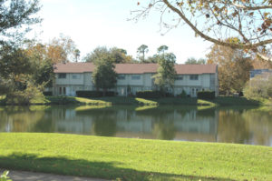 Apartments by pond